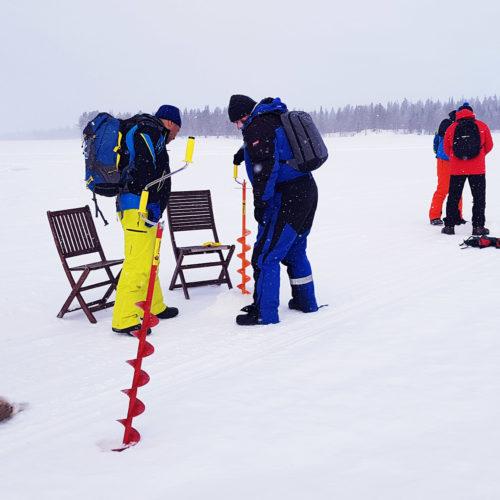 Laponia - łowienie ryb w przeręblu